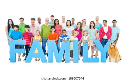 """Multi-ethnic group of people holding """"FAMILY"""" letters"""