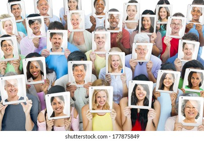 Multi-Ethnic Group of People Holding Tablet