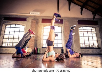 Multi-ethnic group of people training in a gym - Personal  trainer and sportive persons  in a fitness class