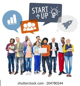Multiethnic Group of People Using Digital Devices with Startup Concept