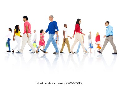 Multi-ethnic group of people walking