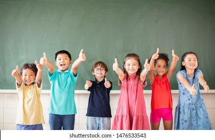 Multi-ethnic group of school children standing in classroom