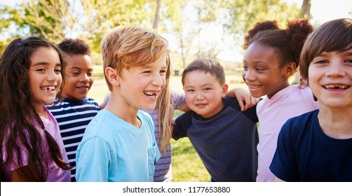 Multi-ethnic group of schoolchildren laughing, outdoors