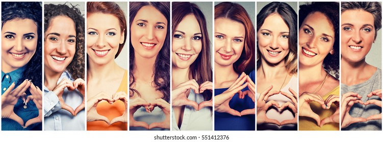 Multiethnic group of smiling cheerful happy women making heart sign with hands