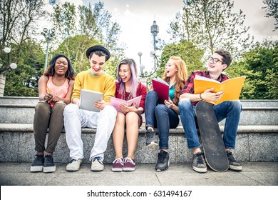 Multi-ethnic group of students stdying together outdoors in a college campus