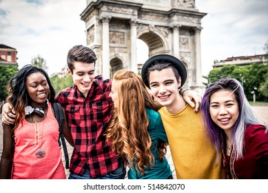 Multi-ethnic group of students studying together outdoors in a college campus