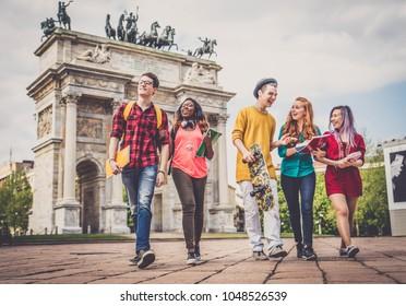 Multi-ethnic group of teens bonding outdoors