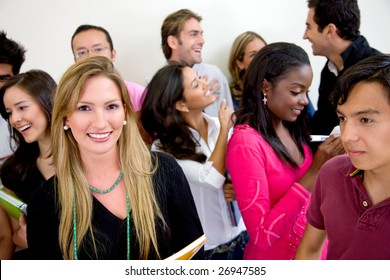 Multi-ethnic group of university students smiling in a classroom