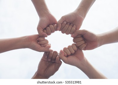 Multiethnic Hands together with group of success collaboration start up business people unite in small business,partners and sponsors who are faithful as well Coming together is a key part of success