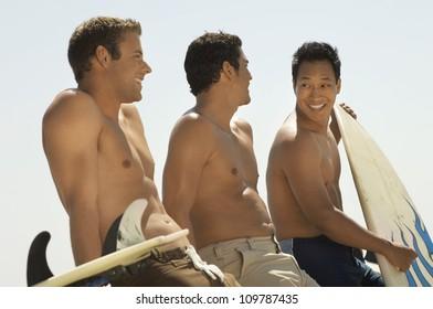 Multiethnic male friends on beach