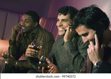 Multi-ethnic men talking on cell phones