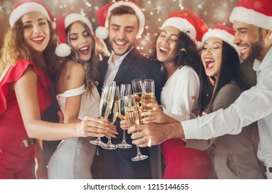 Multiethnic people celebrating New year eve, toasting with champagne flutes, cheers, hooray