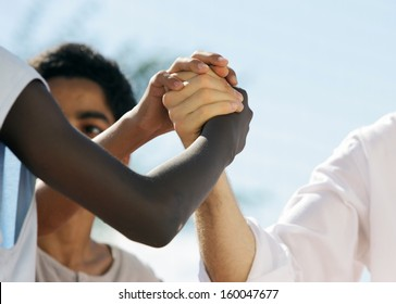 Multi-Ethnic people shaking hands, close up