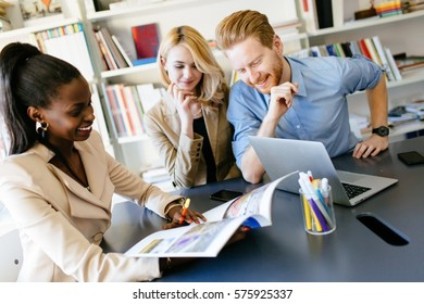 Multiethnic people working in modern well equipped office
