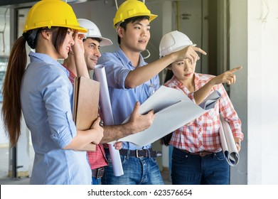 Multiethnic professional construction engineers working with Corporate Colleagues Teamwork and equipment blueprint at the building site place, Industrial engineering Concept