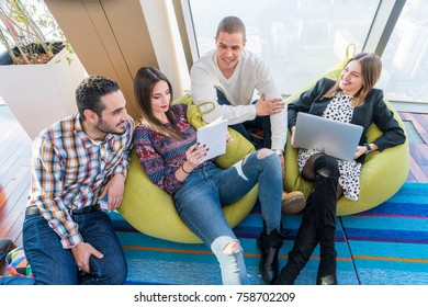 Multiethnic startup business team on meeting in modern bright office interior brainstorming, working on laptop