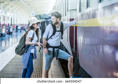 Multiethnic Travelers are getting on the train at the train station, Travel and transportation concept