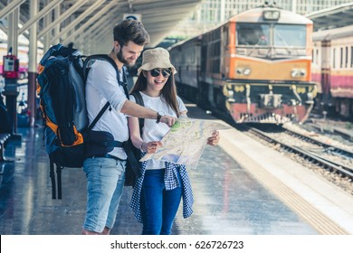 Multiethnic Travelers are looking at the map at the train station, Travel and transportation concept