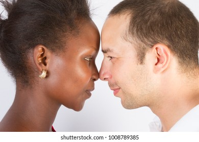 Multi-ethnic two young people of different races looking at each other