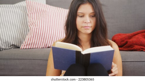 Multiethnic woman having fun reading