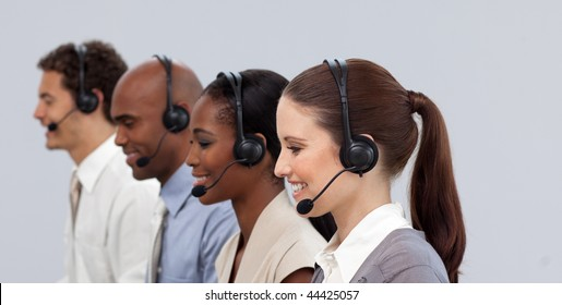 Multi-ethnic young business partners with headset on working in a call center