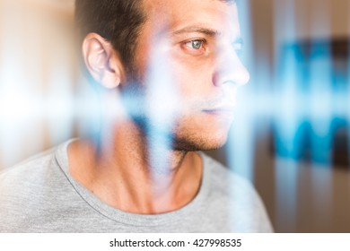 Multiexposure photo of a man and music waves. Hearing, perception of sounds and music