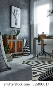 Multifunctional grey apartment with window, dresser and chair