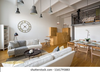 Multifunctional home interior with stylish ceiling beams and mezzanine