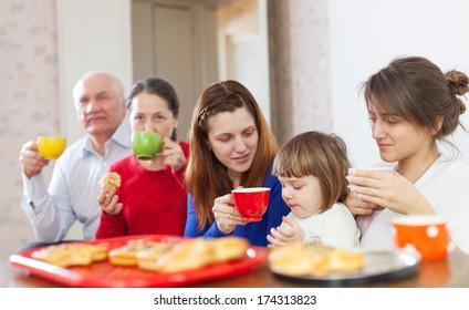 multigeneration family drinks tea at home