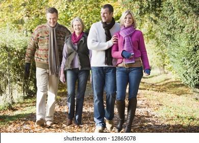 Multi-generation family enjoying walk through autumn woods