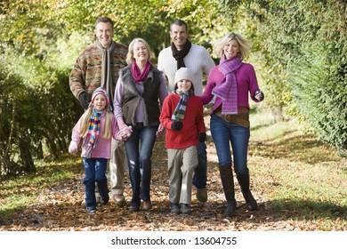 Multi-generation family on walk through autumn woods