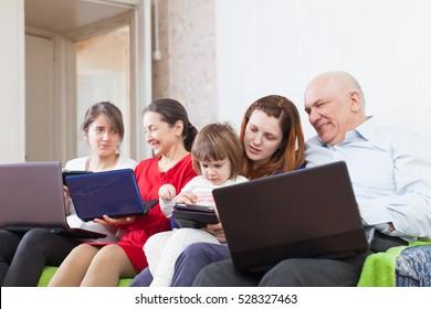 multigeneration family using few laptops in home