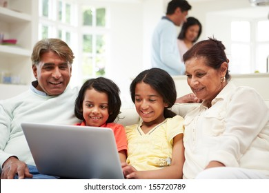 Multi-Generation Indian Family With Laptop