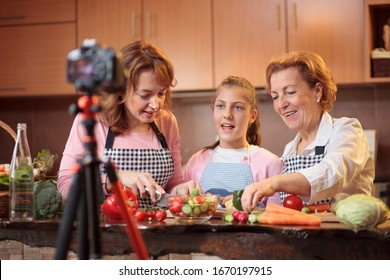 Multi-generational all female family of influencers creating vlog about healthy eating habits and raw vegan food preparation