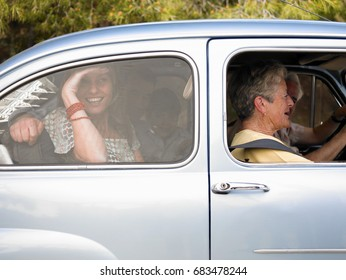 Multi-generational family sitting in car