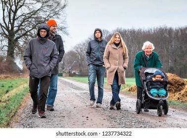 Multi-generational family walking on footpath between fields - Kempen, Germany, Europe