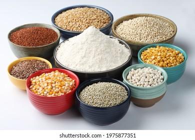 multigrain atta or flour for everyday use at Indian households. wheat, bajra, jowar, corn, rajgira, soyabean, flax seed, chana daal,