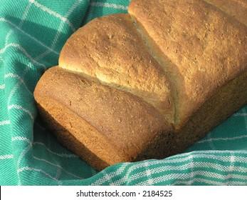 Multi-grain bread in towel