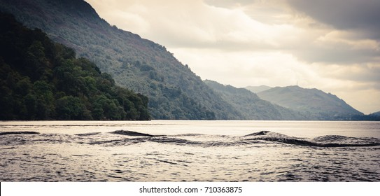 Multi-humped Monster-shaped waves on Loch Ness, Scotland (vintage retro look)