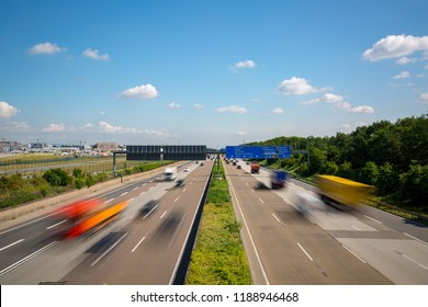 Multilane Autobahn highway with blurred trucks and cars near Frankfurt Airport, Frankfurter Kreuz, Germany