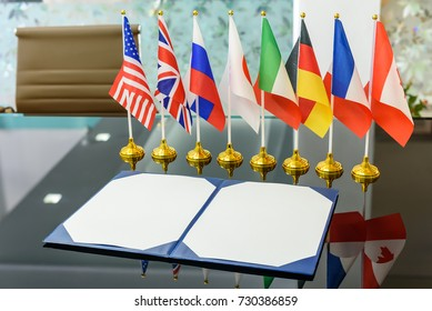 Multilateral trade and military agreement signing concept : National flags of G8 or group of eight major highly industrialized countries i.e Canada, France, Germany, Italy, Japan, Russia, UK, USA