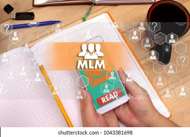 Multi-level marketing. MLM on the touch screen to the network, on office blur background.Concept of Multi-level marketing, MLM