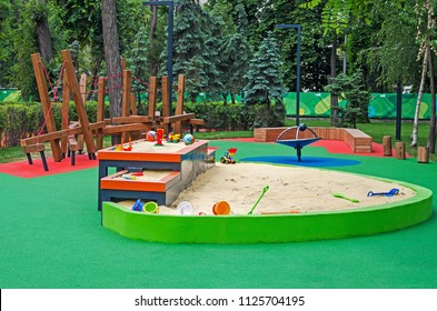 Multi-level sandbox in a children's inclusive gaming park on a summer sunny day