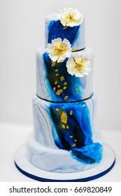 Multilevel wedding cake with flowers.