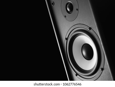 Multimedia system with a large speaker on a black background