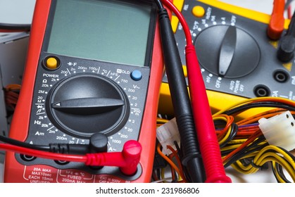 Multimeter. Instrument for measuring voltagered and yellow multimeters for repair equipment