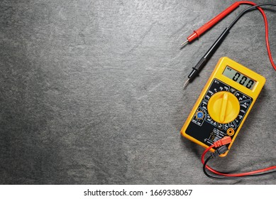 Multimeter on gray flat lay background with copy space.
