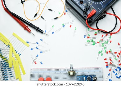 Multimeter, Red Green Blue Diodes, Resistors, Breadboard, Micro Circuits And Wires On The White Background