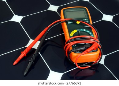 A multimeter rests on a new solar panel