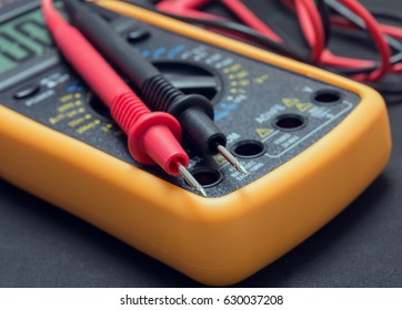 multimeter and tester on black background